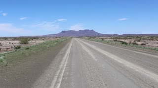 Namibia, Africa - an asphalt road goes into the horizon