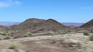 Namibia, Africa - desert landscape - a panorama from the traveling car
