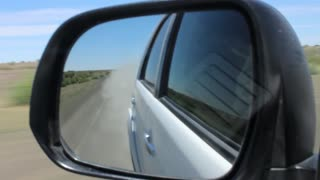 Namibia, Africa - safari on the road - a view through the side rear view mirror