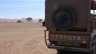 Namibia, Africa - tourist vehicles SUVs are deployed in the desert