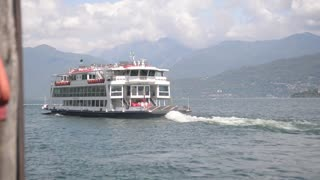 Navigation Lago Maggiore Italy summer. The ferry goes across the lake