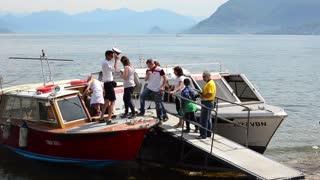 Navigation Lago Maggiore. Passengers enter the boat