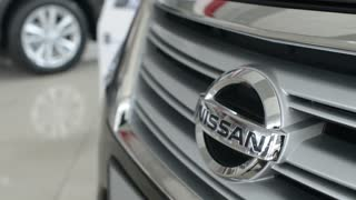 Nissan logo on the bumper of the car