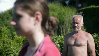 Old man watching a young girl at the pool