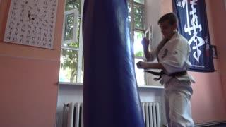 Open Doors Karate Training For Children - Boy hits punching Bag