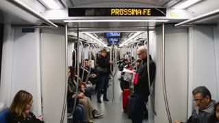 Passengers at Train wagon subway train Milan, reading, waiting