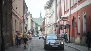 Pedestrians on the streets of Krakow - Old Town restaurants and shops