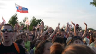 People clap and wave their Hands and dancing at a Gospel Rock Concert