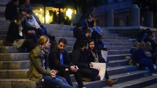People relax and communicate on the steps of the fountain Sisto Rome Italy Night