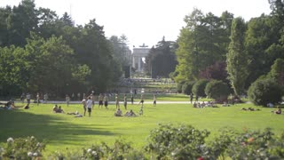 People relaxing in the city of Milan Sempione Park