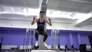 People Training In Crossfit Gym. Jumping on the Box.