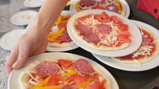 Pizzeria - waiter carries children's pizza