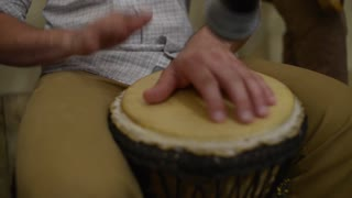 Playing Bongo Drum Close Up - Hand Tapping A Bongo Drum In Close