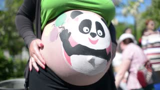 Pregnant female belly And Body Art Artist - at the Park sunny day