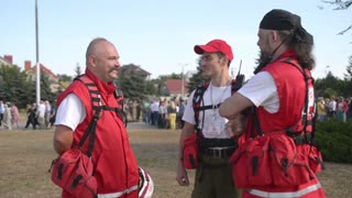 Representatives of the Red Cross work in crowded areas