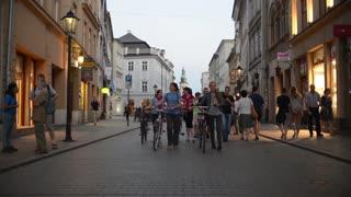 Riding Bikes Through Town evening Krakow Poland