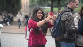 Rome Antique Site, Coliseum, girl turist make photo selfie via Mobile phone