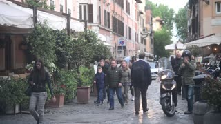 Rome, Italy. Evening in Trastevere, people walk along narrow cozy streets