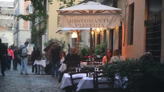 Rome Italy, modest cozy cafe on narrow street evening. Night life Trastevere