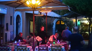 Rome Italy, modest cozy cafe on narrow street evening. Night life Trastevere