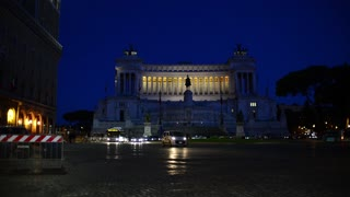 Rome Italy night traffic on Piazza Venezia