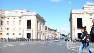 Rome, Italy. People and traffic on Conciliazione street near St. Peter's Square