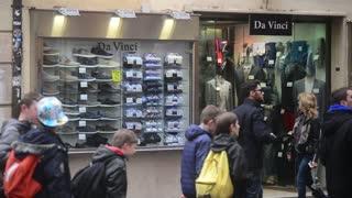 Rome, Italy. Tourists walk along the shop windows
