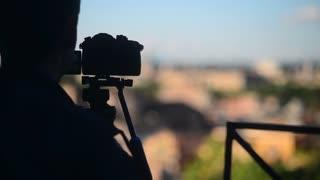 Rome panorama of evening golden city - photographer with camera