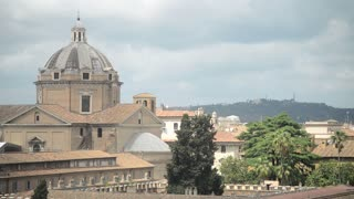 Rome - panorama view of houses and roofs of cathedrals dome