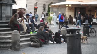Rome, Trastevere - poor and homeless people are sitting at the fountain