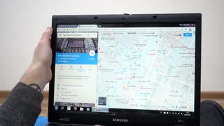 Searching address in New York in Google maps - man using Laptop planning travel