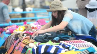 seller arranges goods bags and things on the counter - flea market
