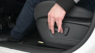setting driver seat up and down in a new modern car Nissan
