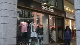 Shopping in Milan, mannequin with clothes in the shop window Adidas