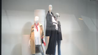 Shopping in Milan, mannequin with clothes in the shop window