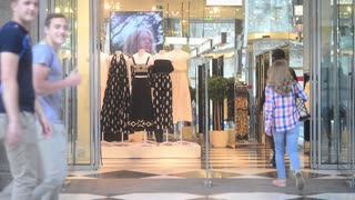 Shopping in Milan, Visitors come to the store with glass showcases