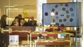 Shopping in Milan, visitors to the store handbags in showcase