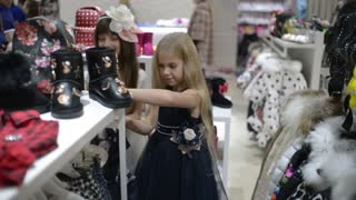 Shopping little Girls In Clothes Store