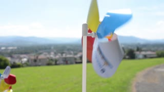 small plastic windmill spinning in the wind