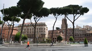 Sport Man running by Antique site of Rome Italy