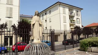 Statue of Virgin Mary - Architecture of suburb of Milan Italy