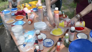 street artists and a table with different paints and brushes