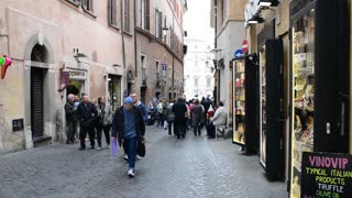 Street of Rome Italy. Tourists and  souvenir shops and clothing stores handbags