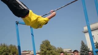 street workout on the bar - the guy flips