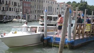 Summer in the streets and canals of Venice. Ships are sailing on the water