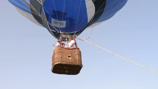 The balloon is inflated with hot air and it rises into the sky
