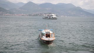The boat sails away from the coast. Navigation Lago Maggiore.