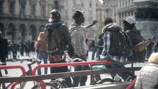 The company of black guys communicates in the center of Milan Italy