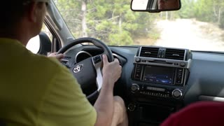 The man Turns The Steering Wheel of Toyota car - extreme driving offroad desert