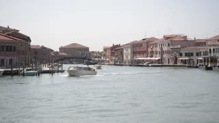 The picturesque canal on the island of Murano in Venice